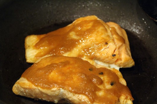 Let salmon cook slowly with sauce