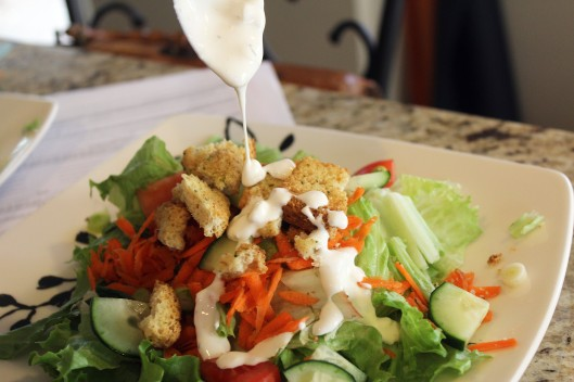 Top salad with dressing